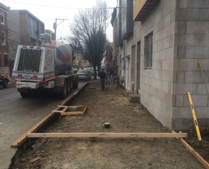 Concrete sidewalk removed and dirt prepped, along with forms being built - Philadelphia