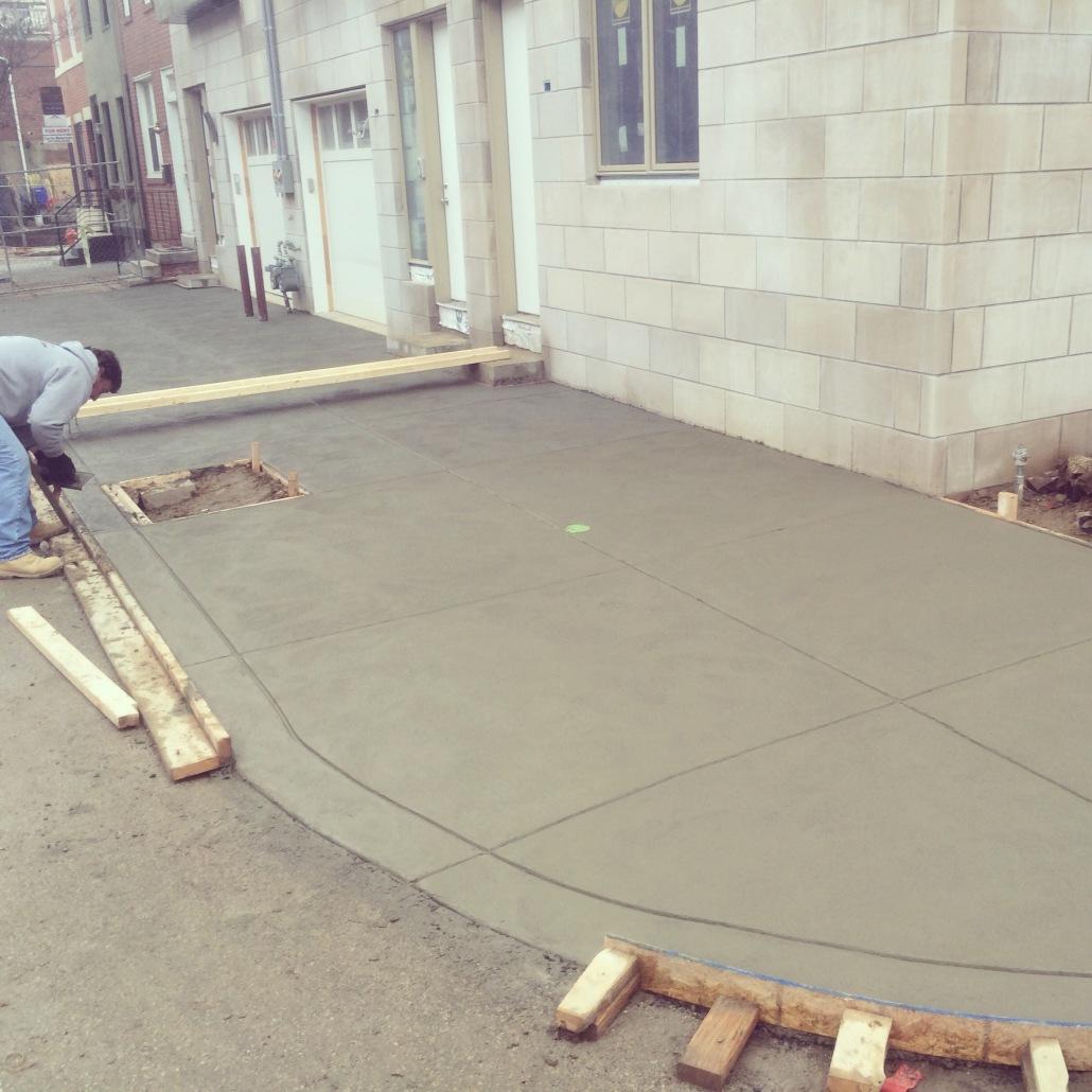 Concrete curb and sidewalk